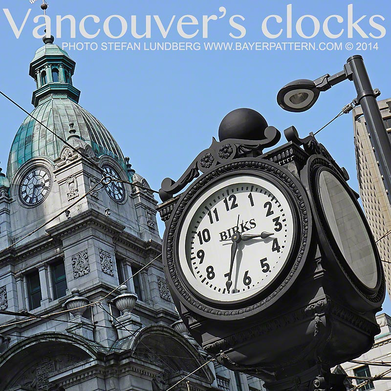 Birks clock in front of the Sinclair clock tower on the corners of Hastings and Granville Street in Vancouver.